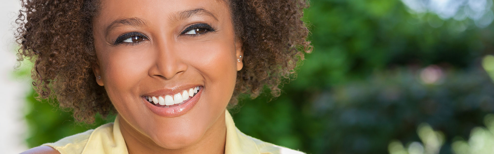 middle-aged woman with a perfect smile after dental cosmetic treatment