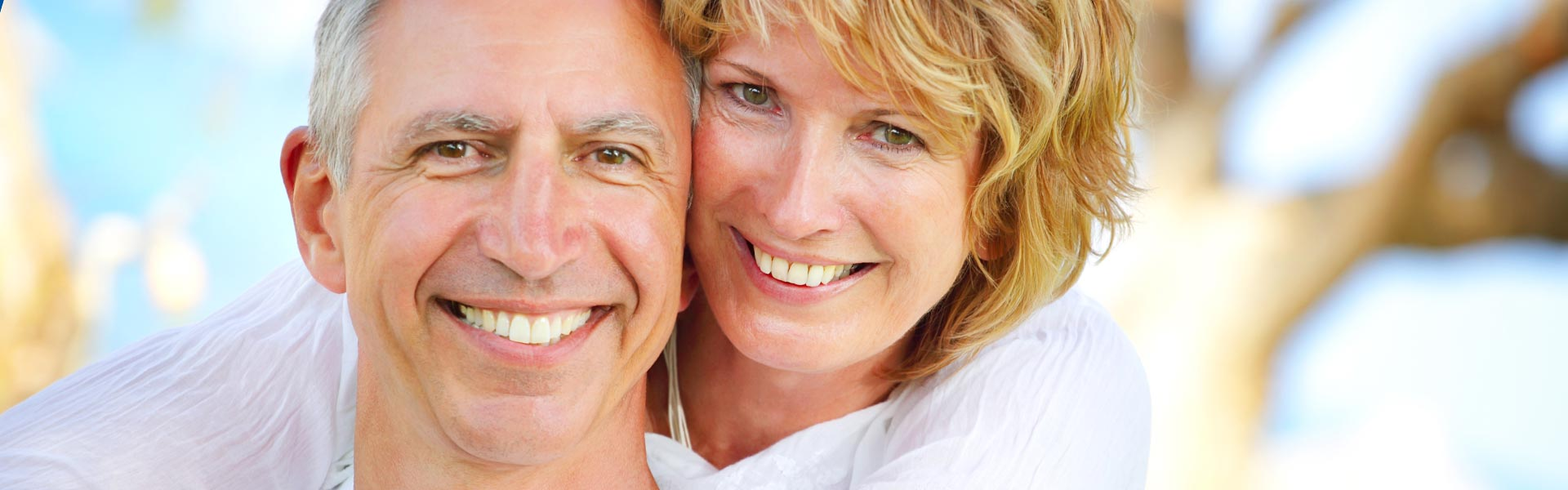 mature couple showing perfect teeth in smile