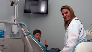 Dr Porcaro and little boy patient in dental chair